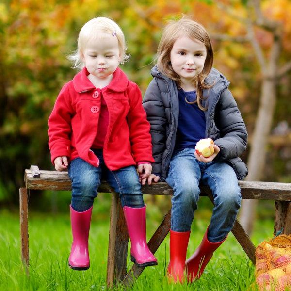 two children eating apple