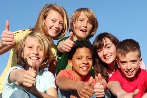 Children thumbs up